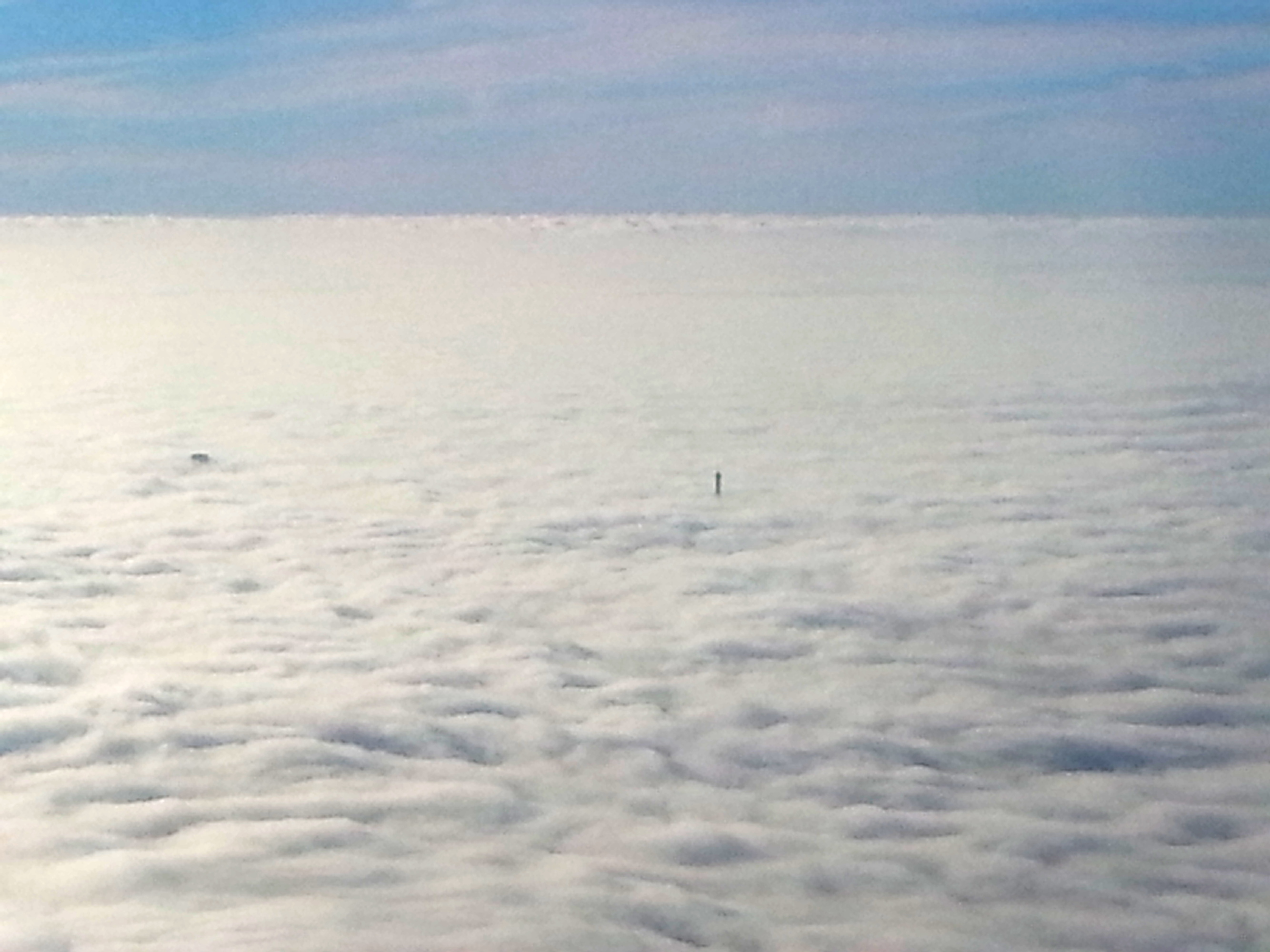 Amazing: Tour Eiffel's summit rising through the low clouds over Paris