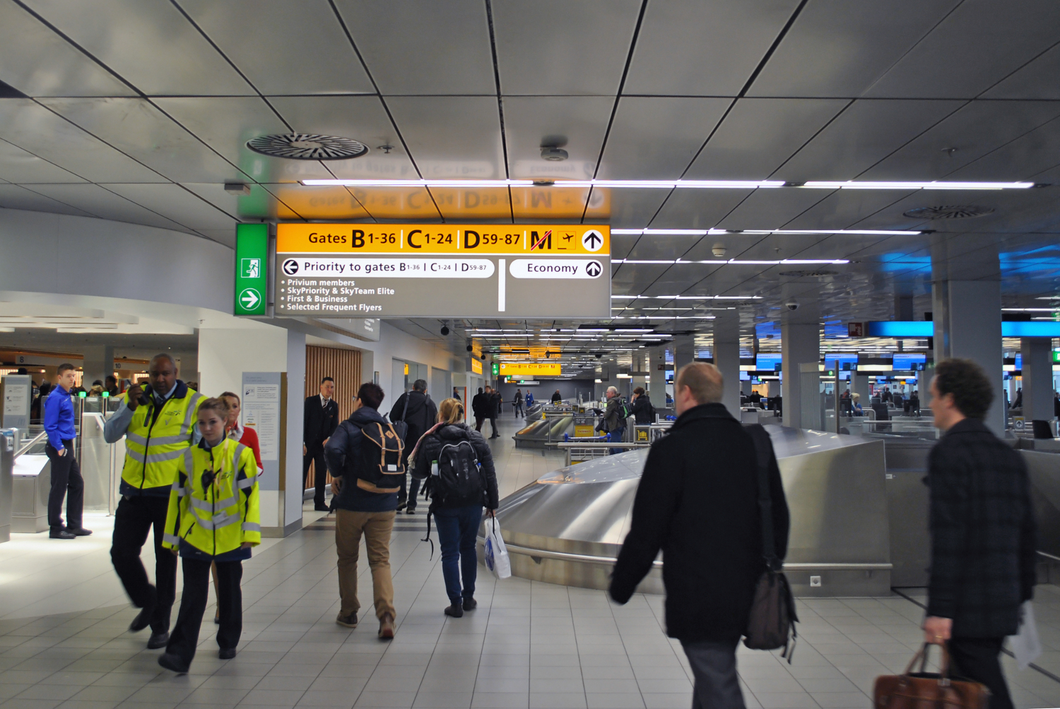 Airplane passengers hurrying to the security check on Amsterdam Airport Schiphol