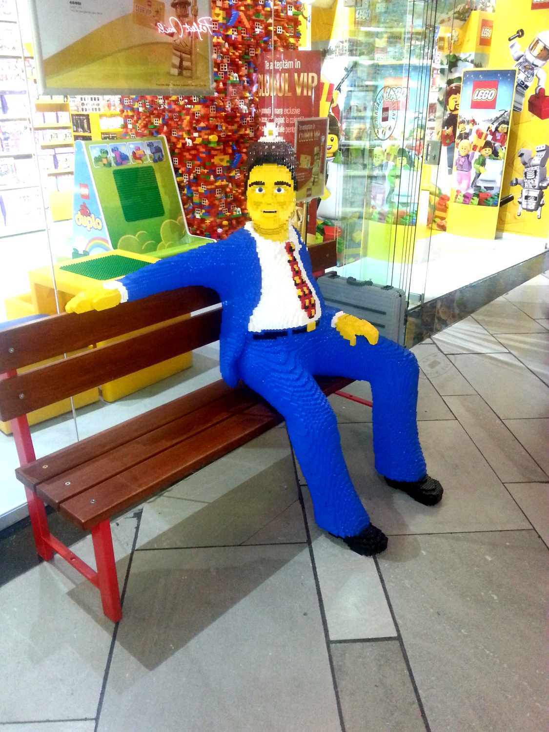 Man in front of the Lego shop