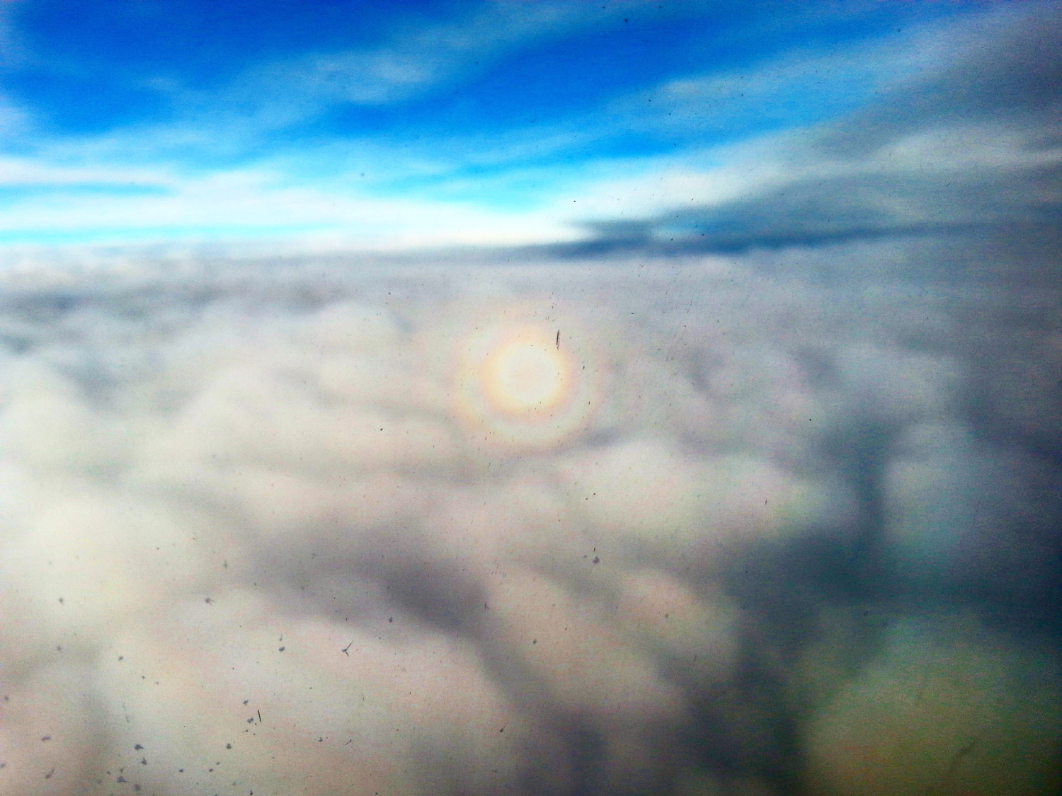 Triple circular rainbow seen from an airplane