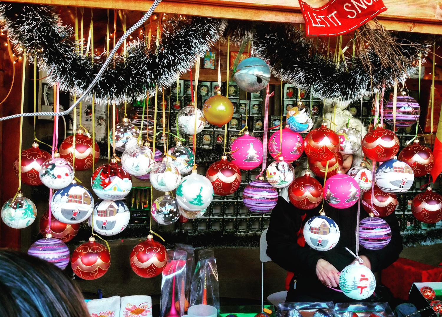 Haind painted Christmas globes at the Bucharest Christmas Fair. Read this article and find out all you need to know about visiting Bucharest Christmas Market. #christmas #bucharestchristmasmarket #bucharestdecember #christmasmarket