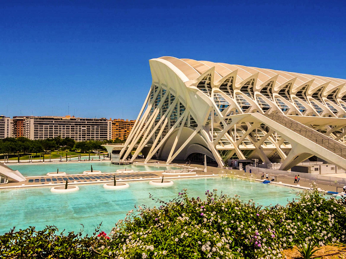 City of Arts of Sciences, Valencia, Spain (Ciudad de Las Artes y Las Ciencias). This futuristic building is among the top things to see in Valencia on your trip. Read the article to discover the perfect 2 day itinerary for Valencia Spain recommended by a local #valencia #spain #valenciaitinerary #valenciatravel #itineraryvalencia Photo by Would Be Traveller