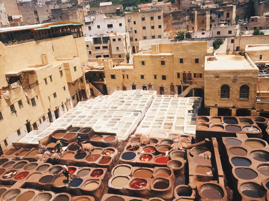 Leather tannery in Morocco. One of the things you need to know when traveling to Morocco is that Be prepare to haggle in markets - this is one of the things you need to know when traveling to Morocco  #Morocco  #moroccotravel #traveltips