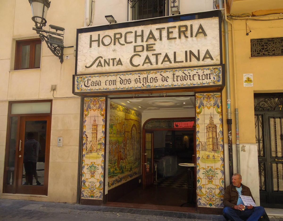 Have a snack at Horchateria Santa Catalina in Valencia, a must do while visiting Valencia. Read the article to discover the perfect 2 day itinerary for Valencia Spain recommended by a local, including what to see in Valencia and what to eat in Valencia #valencia #spain #valenciaitinerary #valenciatravel #itineraryvalencia Photo by Would Be Traveller