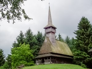Barsana Church, Maramures, Romania - one of the must-see UNESCO World Heritage Sites in Europe. Discover the best UNESCO sites in Europe recommended by travel bloggers from this article. #UNESCO #unescosites #unescositeseurope #europeunesco