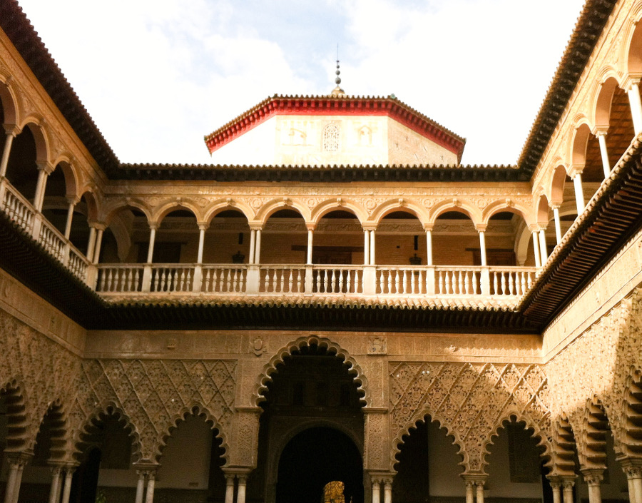 The Courtyard of the Royal Alcazar of Seville, Spain. Read this article and discover top UNESCO World Heritage Sites in Europe recommended by travel bloggers. #UNESCO #unescosites #unescositeseurope #europeunesco #spainunesco #spain