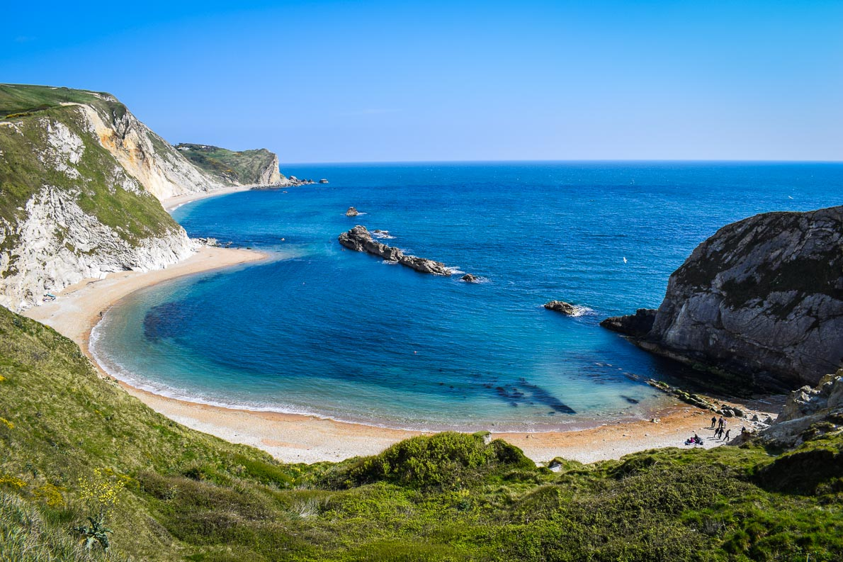 The Jurassic Coast is the UK's first natural World Heritage Site. Read this article and discover top UNESCO World Heritage Sites in Europe recommended by travel bloggers. #UNESCO #unescosites #unescositeseurope #europeunesco #ukunesco #uk