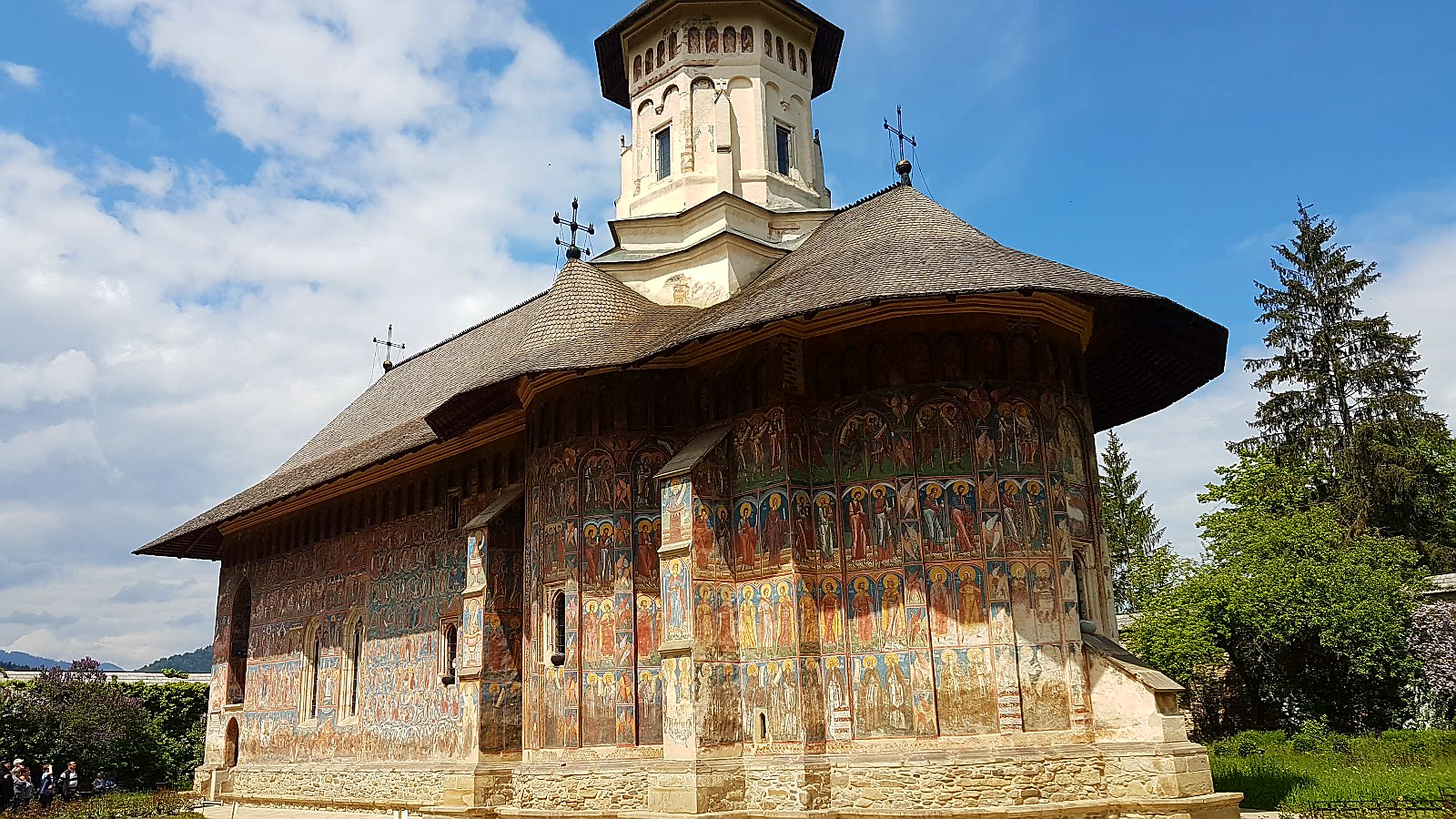 Moldovita Church, one of the painted monasteries, Romania - a great UNESCO heritage site in Europe. Read this article to discover more stunning UNESCO World Heritage Sites in Europe, including UNESCO monuments. #UNESCO #unescosites #unescositeseurope #europeunesco #romaniaunesco #romania