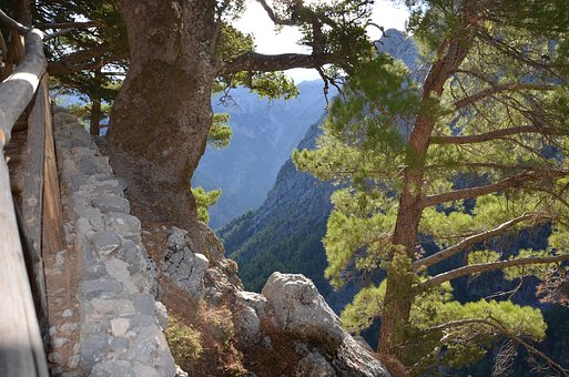 The Samaria Gorge, Crete, Greece. This is a UNESCO World Heritage Site in Europe. Read this article to see more amazing UNESCO sites in Europe to adfd them to your Europe bucket list. #UNESCO #unescosites #unescositeseurope #europeunesco #greeceunesco #greece