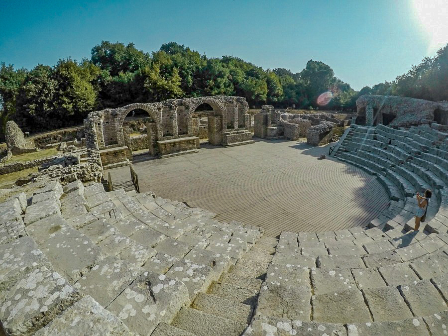 Theater - Butrint, Albania - one of the UNESCO Heritage Sites in Europe. Discover more amazing heritage sites in Europe from this article. #UNESCO #unescosites #unescositeseurope #europeunesco #albaniaunesco #albania