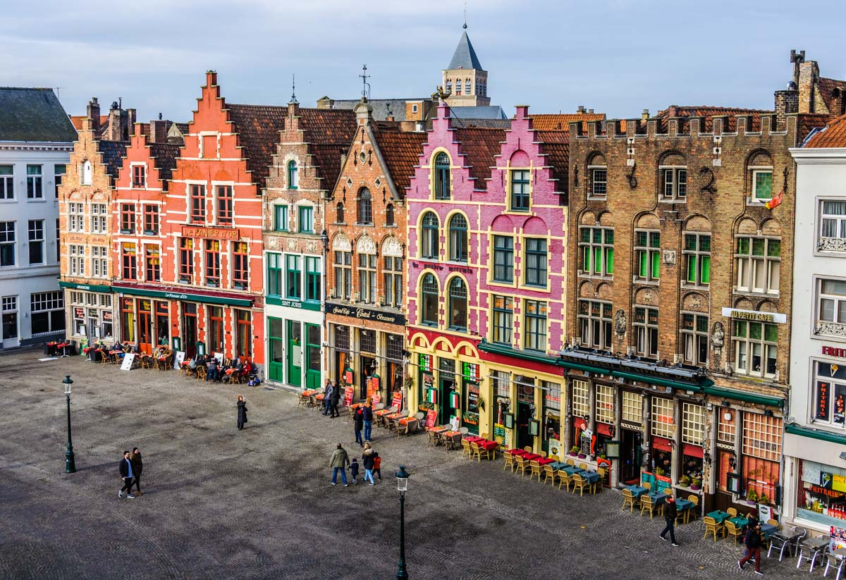 Colorful old brick buildings in Bruges, Belgium. Bruges has one of the best UNESCO heritage sites in Europe. Read the article to discover more natural sites in Europe, and a list of world heritage in Europe to add to your bucket list. #UNESCO #unescosites #unescositeseurope #europeunesco #belgiumunesco #belgium