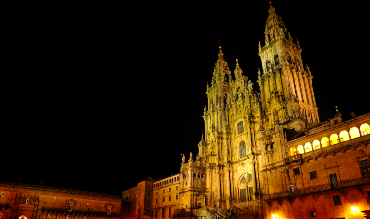 Cathedral of Santiago de Compostela in Galicia at night. Santiago de Compostela (Old Town), Spain is one of the best UNESCO heritage sites in Europe. Read the article to discover more natural sites in Europe, and a list of world heritage in Europe to add to your bucket list. #UNESCO #unescosites #unescositeseurope #europeunesco #spainunesco #spain