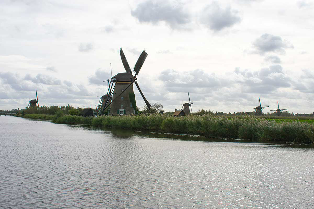 Kinderdijk Windmills, The Netherlands are one of the best UNESCO monuments in Europe. Read the article to discover more natural sites in Europe, and a list of world heritage in Europe to add to your bucket list. #UNESCO #unescosites #unescositeseurope #europeunesco #netherlandsunesco #netherlands