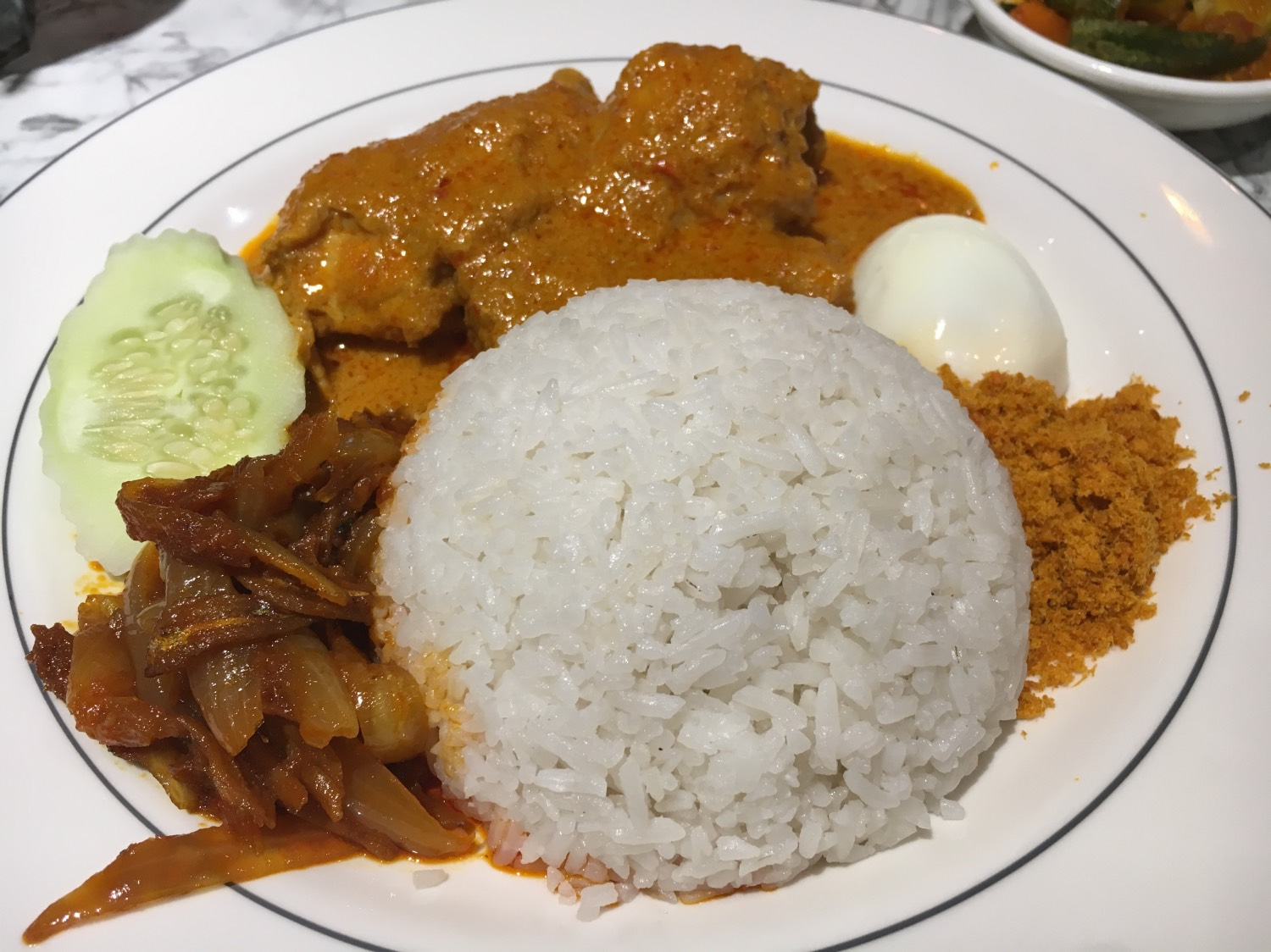 traditional Malay breakfast - Nasi Lemak. This is one of the best things to do in Kuala Lumpur, Malaysa in 2 days. Read the article for a complete 2-day itinerary for KL. #kl #malaysia. #klitinerary #2daykualalumpur #kualalumpurguide #kualalumpurtraveling #kualalumpuritinerary #klitinerary