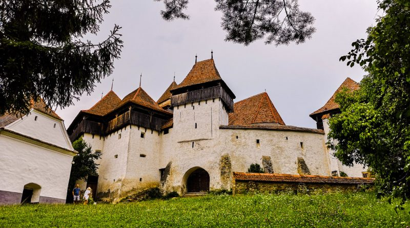 The fortified church in Viscri, Romania is one of the best UNESCO monuments in Europe. Read the article to discover more natural sites in Europe, and a list of world heritage in Europe to add to your bucket list. #UNESCO #unescosites #unescositeseurope #europeunesco #romaniaunesco #romania