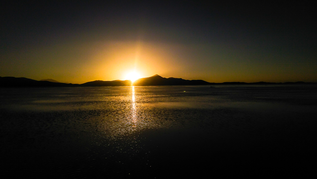 Sunset in Salar de Uyuni. What do to in Uyuni Salt Flats, Bolivia