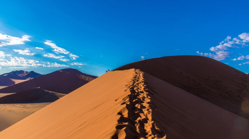 Hiking dune 45 in Sossusvlei, Namibia. Here are the best places to visit in Namibia and the most amazing thinfs to see in Namibia