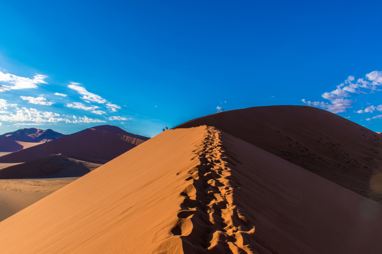 Hiking dune 45 in Sossusvlei, Namibia. Here are the best places to visit in Namibia and the most amazing things to see in Namibia