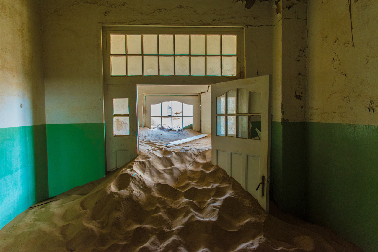 One of Kolmanskop's abandoned houses, Namibia. Use this Namibia travel information to plan your Namibia trip and decide what to do in Namibia