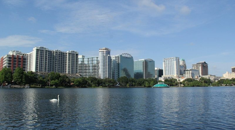 Riding swan boats at Lake Eola Park is one of the fun things to do in Orlando beyond the amusement parks